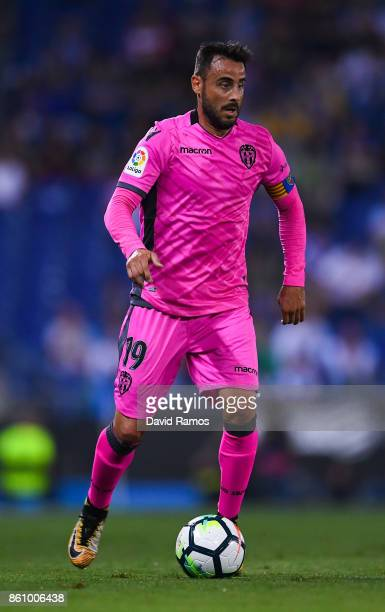 Pedro Lopez of Levante UD runs with the ball during the La Liga match between Espanyol and Levante at CornellaEl Prat stadium on October 13 2017 in...