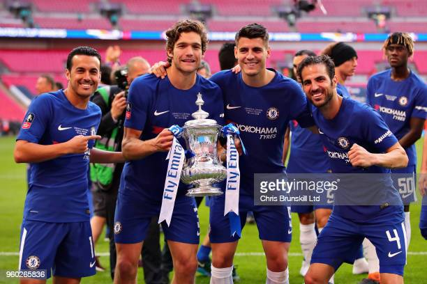 Pedro Marcos Alonso Alvaro Morata and Cesc Fabregas all of Chelsea celebrate with the FA Cup trophy after the Emirates FA Cup Final between Chelsea...