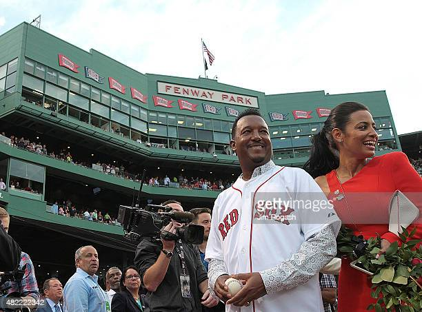 Pedro Martinez a former member of the Boston Red Sox and his wife Carolina leave the field after a ceremony to retire Martinez's number 45 before a...