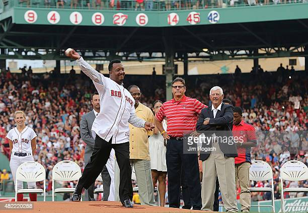 Pedro Martinez a former member of the Boston Red Sox throws out the first pitch during a ceremony to retire Martinez's number 45 before a game with...