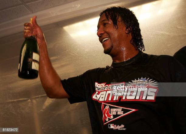Pedro Martinez and of the Boston Red Sox celebrate after defeating the New York Yankees 103 to win game seven of the American League Championship...