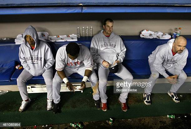 Pedro Martinez David Ortiz Derek Lowe and John Burkett sit in the dugout after the Red Sox's 11 inning loss