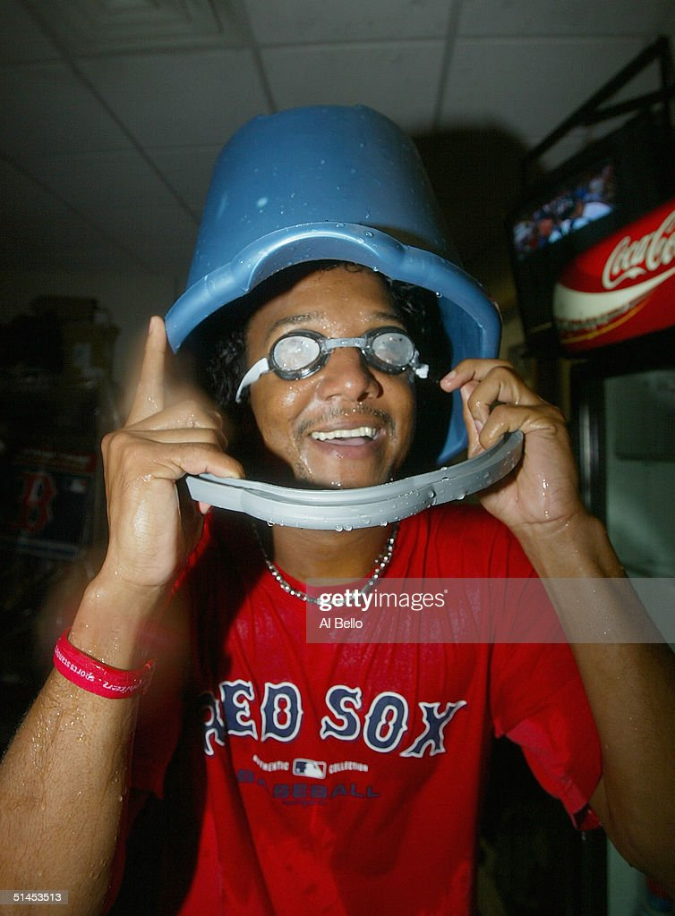 Pedro Martinez #45 of the Boston Red Sox celebrates in the locker room after defeating the Anaheim Angels 8-6 in Game 3 of the American League Division Series on October 8, 2004 at Fenway Park in Boston, Massachusetts. The Red Sox sweep the series 3-0.