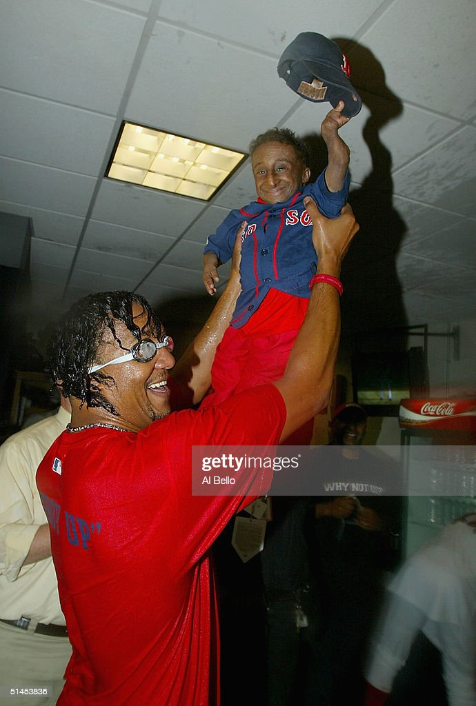 Pedro Martinez #45 of the Boston Red Sox holds aloft his friend Nelson De La Rosa during a celebration of the team's win over the Anaheim Angels 8-6 in Game 3 of the American League Division Series on October 8, 2004 at Fenway Park in Boston, Massachusetts. The Red Sox swept the best-of-five series.