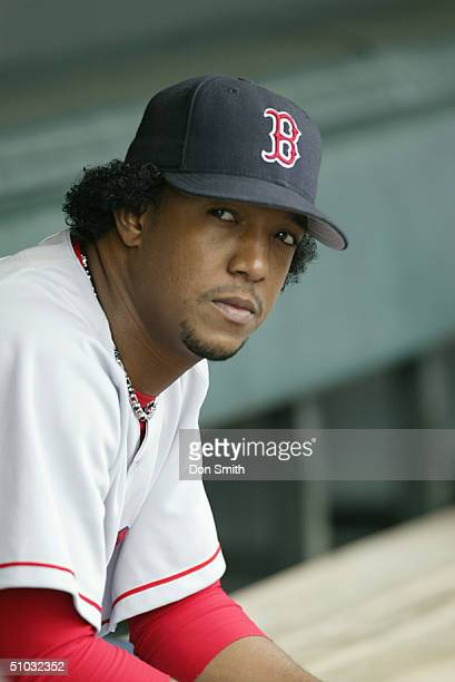 Pedro Martinez of the Boston Red Sox sits in dugout during the MLB game against the San Francisco Giants at SBC Park on June 19 2004 in San Francisco...