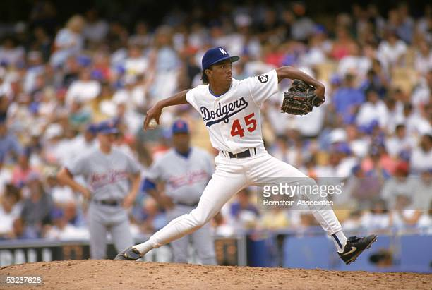 Pedro Martinez of the Los Angeles Dodgers winds back to pitch during a game against the New York Mets on July 241993 at Dodger Stadium in Los Angeles...