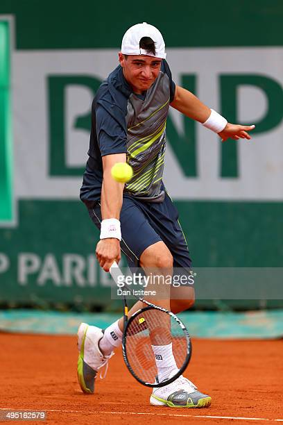 Pedro Martinez Portero of Spain returns a shot during his boys' singles match against Daniil Medvedev of Russia on day eight of the French Open at...