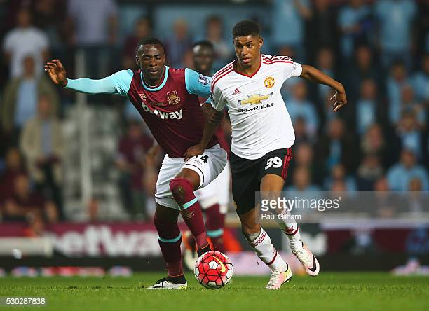 Pedro Mba Obiang of West Ham United and Marcus Rashford of Manchester United battle for the ball during the Barclays Premier League match between...