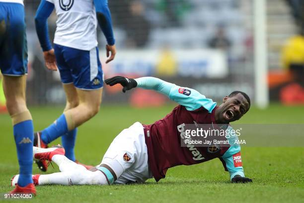 Pedro Mba Obiang of West Ham United reacts after a challenge with Max Power of Wigan Athletic which results in him going off injured during the The...