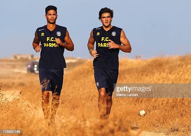 Pedro Mendes and Alvaro Ampuero of Parma FC run during a Parma FC preseason training session at Rosa Marina Resort on July 11 2013 in Ostuni Italy