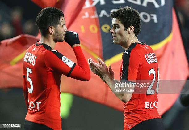 Pedro Mendes and Yoann Gourcuff of Rennes celebrate the victory following the French Ligue 1 match between Stade Rennais FC and SCO Angers at Roazhon...