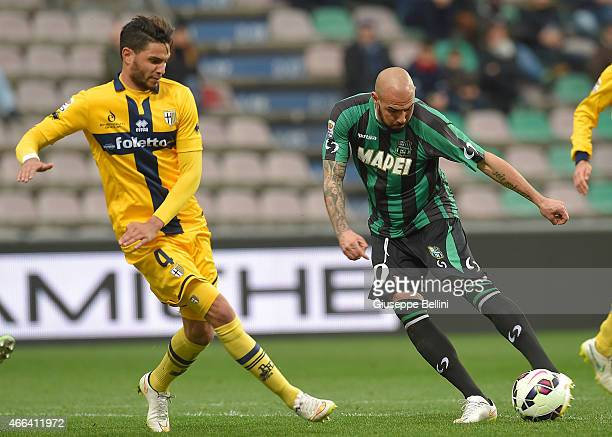 Pedro Mendes of Parma and Simone Zaza of Sassuolo in action the Serie A match between US Sassuolo Calcio and Parma FC at Mapei Stadium on March 15...