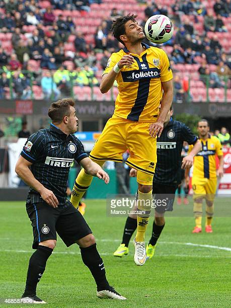 Pedro Mendes of Parma FC is challenged by Xherdan Shaqiri of FC Internazionale Milano during the Serie A match between FC Internazionale Milano and...