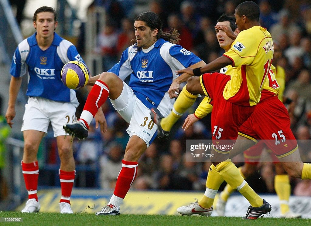 Pedro Mendes of Portsmouth wins the ball from Ashley Young of Watford during the Barclays Premiership match between Portsmouth and Watford at Fratton Park on November 18, 2006 in Portsmouth, United Kingdom.