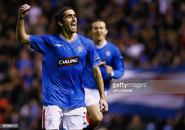 Pedro Mendes of Rangers celebrates after scoring against Unirea Urziceni during the UEFA Champions League Group G match between Rangers and Unirea...
