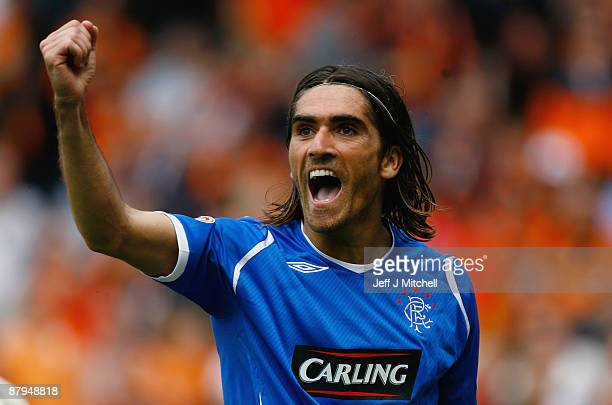 Pedro Mendes of Rangers celebrates after scoring the second goal during the Scottish Premier League match between Dundee United and Rangers at...