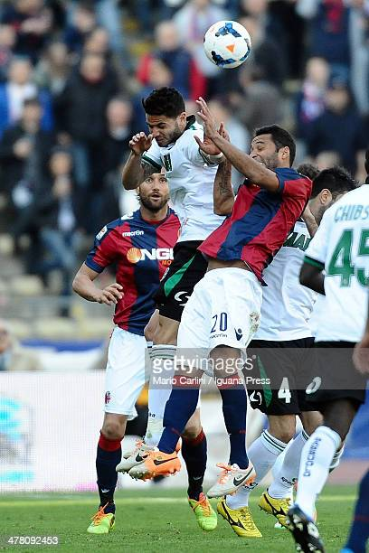 Pedro Mendes of US Sassuolo Calcio competes the ball with Barreto Ibson of Bologna FC during the Serie A match between Bologna FC and US Sassuolo...