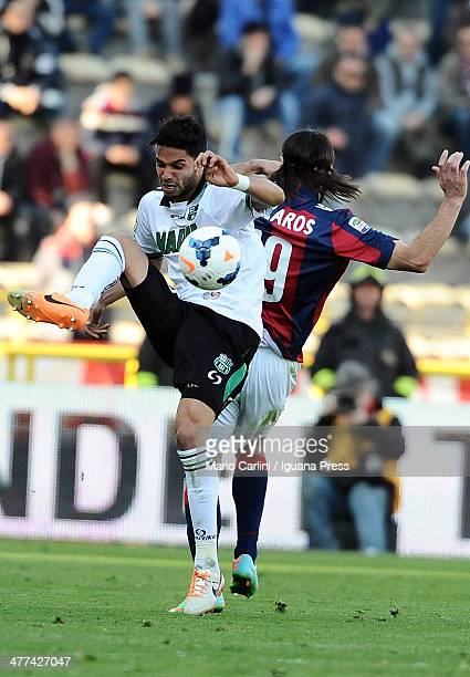 Pedro Mendes of US Sassuolo Calcio competes the ball with Lazaros of Bologna FC during the Serie A match between Bologna FC and US Sassuolo Calcio at...