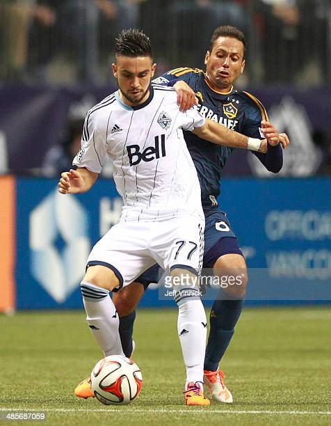 Pedro Morales of the Vancouver Whitecaps FC and Marcelo Sarvas of the Los Angeles Galaxy battle for the ball during their MLS game April 19 2014 in...