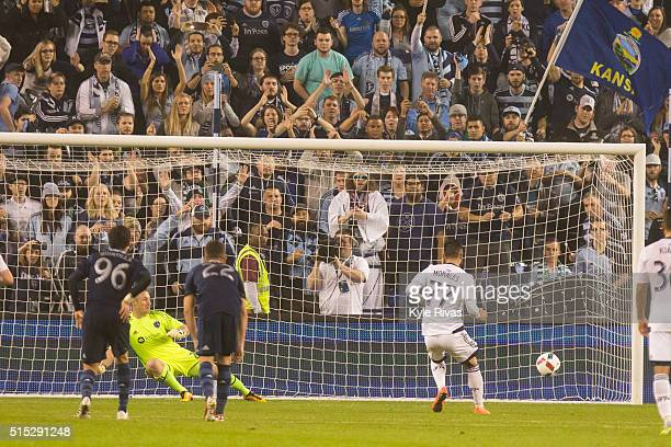 Pedro Morales of Vancouver Whitecaps scores on a penalty kick against Tim Melia of Sporting Kansas City in the second half on March 12 2016 at...