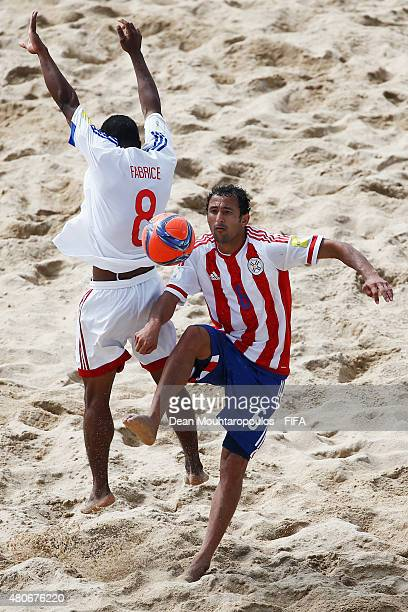 Pedro Moran of Paraguay competes for the ball with Fabrice Domona of Madagascar during the Group D FIFA Beach Soccer World Cup match between Paraguay...