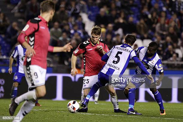 Pedro Mosquera of Deportivo de La Coruna and Marlos Moreno of Deportivo de La Coruna compete for the ball against Aleksandar Katai of Deportivo...