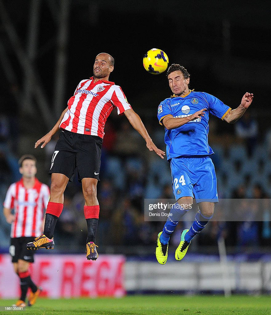 Pedro Mosquera (R) of Getafe is tackled by Mikel Rico of Athletic Club during the La Liga match between Getafe CF and Athletic Club at Coliseum Alfonso Perez stadium on October 28, 2013 in Getafe, Spain.