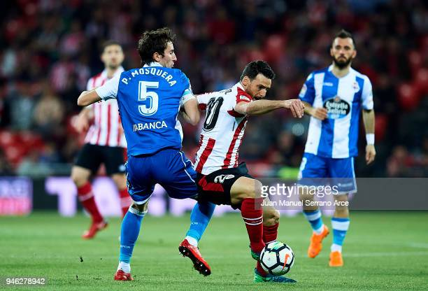 Pedro Mosquera of RC Deportivo La Coruna competes for the ball with Aritz Aduriz of Athletic Club during the La Liga match between Athletic Club...
