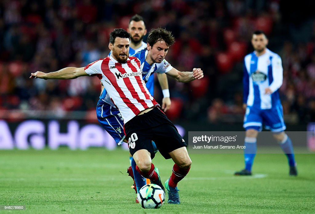 Pedro Mosquera of RC Deportivo La Coruna competes for the ball with Aritz Aduriz of Athletic Club during the La Liga match between Athletic Club Bilbao and RC Deportivo La Coruna at San Mames Stadium on April 14, 2018 in Bilbao, Spain.