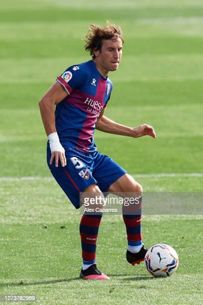 Pedro Mosquera of SD Huesca plays the ball during the La Liga Santander match between SD Huesca and Cadiz CF at Estadio El Alcoraz on September 20...