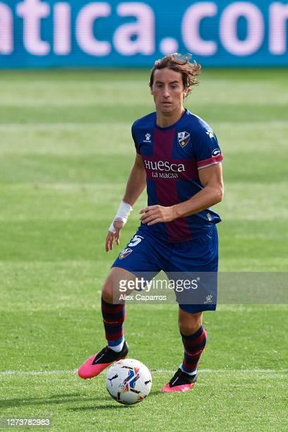 Pedro Mosquera of SD Huesca runs with the ball during the La Liga Santander match between SD Huesca and Cadiz CF at Estadio El Alcoraz on September...