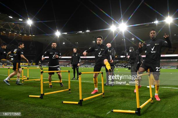 Pedro Neto and Nelson Semedo of Wolverhampton Wanderers warm up with team mates prior to the Premier League match between Wolverhampton Wanderers and...