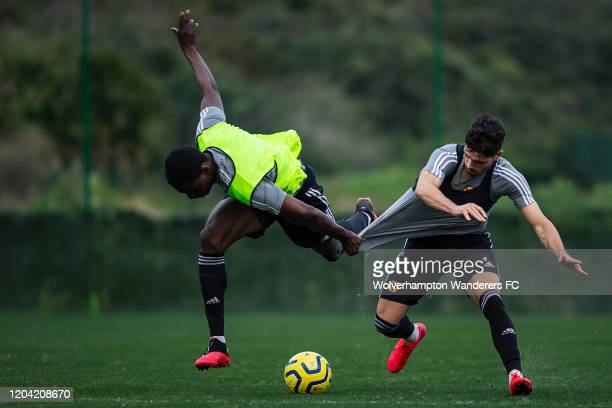 Pedro Neto competes with Owen Otasowie during Wolverhampton Wanderers Training Session at La Quinta Football Fields on February 05, 2020 in Marbella,...