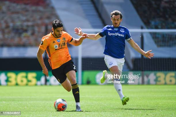 Pedro Neto of Wolverhampton Wanderers and Leighton Baines of Everton during the Premier League match between Wolverhampton Wanderers and Everton FC...