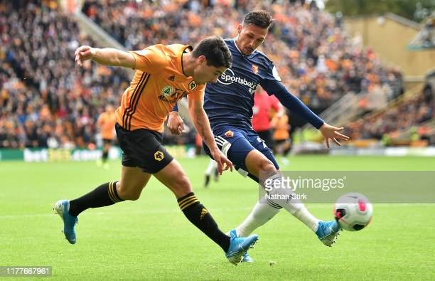 Pedro Neto of Wolverhampton Wanderers battles for possession with Jose Holebas of Watford during the Premier League match between Wolverhampton...