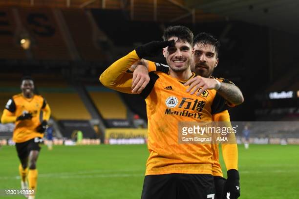 Pedro Neto of Wolverhampton Wanderers celebrates after scoring a goal to make it 2-1 with Ruben Neves during the Premier League match between...