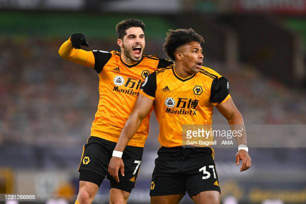 Pedro Neto of Wolverhampton Wanderers celebrates after scoring a goal to make it 1-0 after an own goal by goalkeeper Illan Meslier of Leeds United...