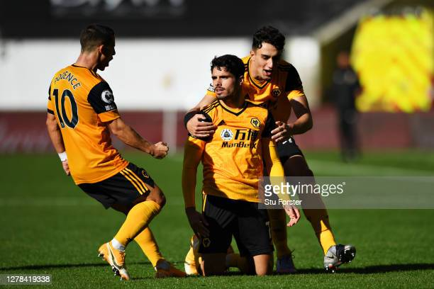 Pedro Neto of Wolverhampton Wanderers celebrates after scoring his sides first goal with his teamates during the Premier League match between...