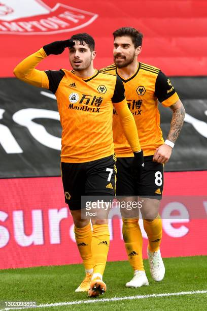 Pedro Neto of Wolverhampton Wanderers celebrates after scoring their team's second goal with teammate Ruben Neves during the Premier League match...