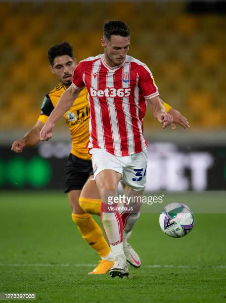 Pedro Neto of Wolverhampton Wanderers chases Jordan Thompson of Stoke City during the Carabao Cup second round match between Wolverhampton Wanderers...