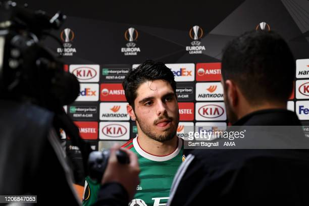 Pedro Neto of Wolverhampton Wanderers gets interviewed after the UEFA Europa League round of 16 first leg match between Olympiacos FC and...