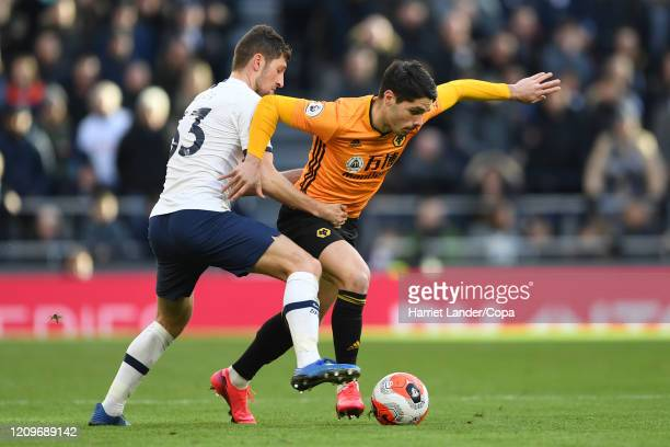 Pedro Neto of Wolverhampton Wanderers is challenged by Ben Davies of Tottenham Hotspur during the Premier League match between Tottenham Hotspur and...