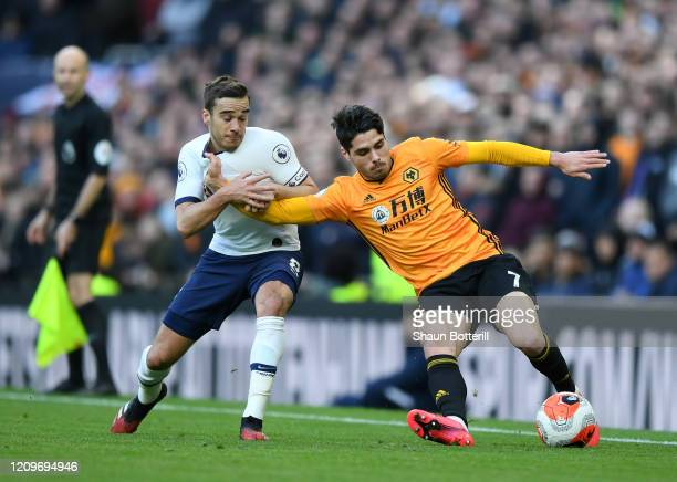 Pedro Neto of Wolverhampton Wanderers is challenged by Harry Winks of Tottenham Hotspur during the Premier League match between Tottenham Hotspur and...