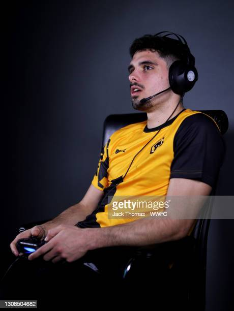 Pedro Neto of Wolverhampton Wanderers plays Fortnite online with YouTuber MrSavage at Sir Jack Hayward Training Ground on March 03, 2021 in...