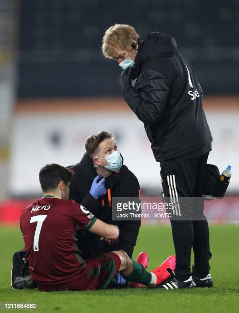 Pedro Neto of Wolverhampton Wanderers receives medical treatment before going off injured during the Premier League match between Fulham and...