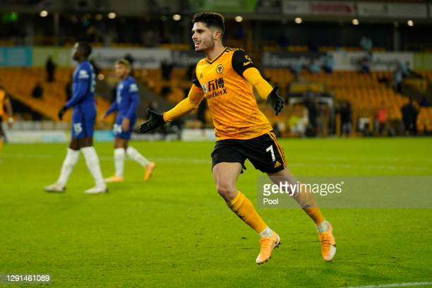 Pedro Neto of Wolves celebrates after scoring their sides second goal during the Premier League match between Wolverhampton Wanderers and Chelsea at...