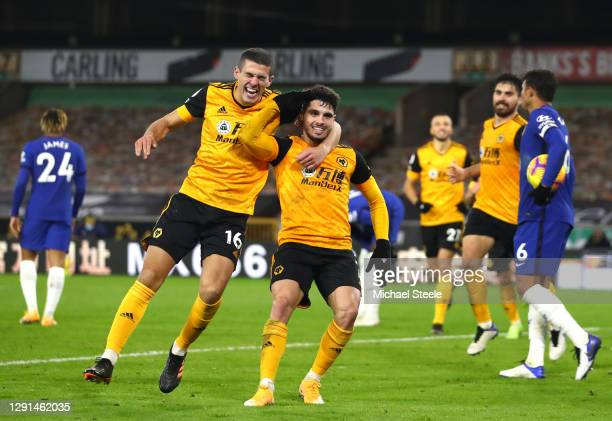 Pedro Neto of Wolves celebrates with teammate Conor Coady after scoring their sides second goal during the Premier League match between Wolverhampton...