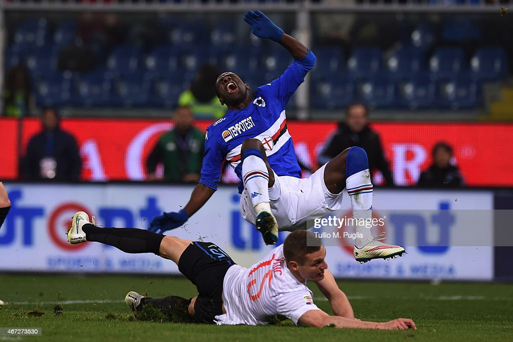 Pedro Obiang (Top) of Sampdoria is challenged by Nemanja Vidic of Internazionale Milano in action during the Serie A match between UC Sampdoria and FC Internazionale Milano at Stadio Luigi Ferraris on March 22, 2015 in Genoa, Italy.