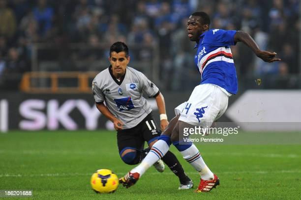 Pedro Obiang of UC Sampdoria in action against Maximiliano Moralez of Atalanta BC during the Serie A match between UC Sampdoria and Atalanta BC at...