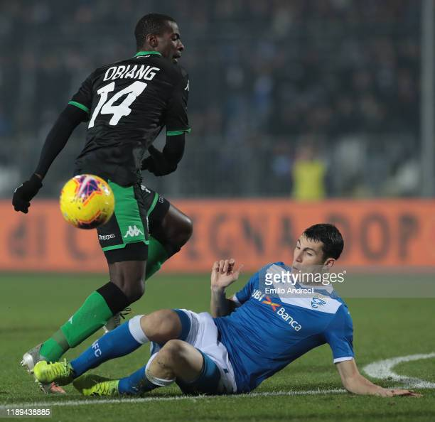 Pedro Obiang of US Sassuolo competes for the ball with Dimitri Bisoli of Brescia Calcio during the Serie A match between Brescia Calcio and US...